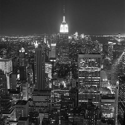 Illuminated Photograph - New York City At Night by Adam Garelick