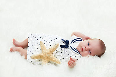 Adorable Photograph - Newborn Baby Lying On White Fur. Maritime Composition With Starfish And Sailor Dress by Michal Bednarek