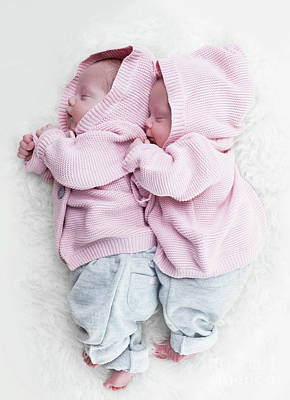 Hug Photograph - Newborn Twins Sisters Sleeping On White Fur Together In Cute Pink Sweaters by Michal Bednarek