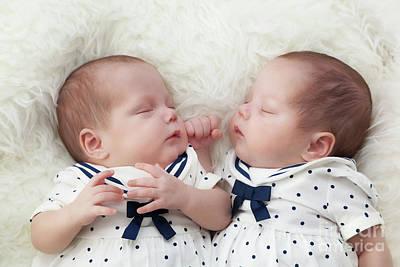 Sleep Photograph - Newborn Twins Sisters Sleeping On White Fur, Wearing Sailor Dresses by Michal Bednarek