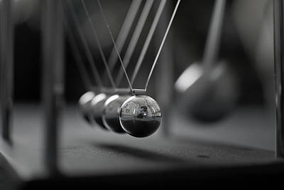 Newton Photograph - Newton's Cradle In Motion - Metallic Balls by N.J. Simrick