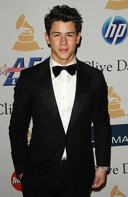 In Attendance Photograph - Nick Jonas In Attendance For Clive by Everett