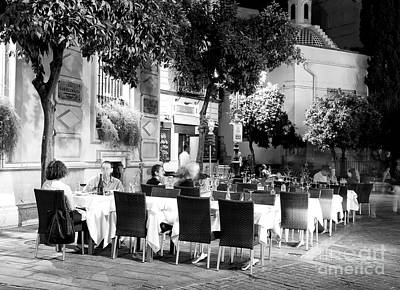 Photograph - Night Dining In The Plaza Virgen De Los Reyes by John Rizzuto
