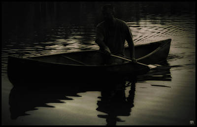 Photograph - Night Paddler by John Meader