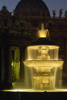 Piazza San Pietro Photograph - Night View Of A Fountain Outside Saint by James L. Stanfield