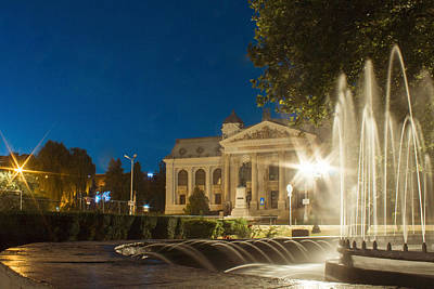 Photograph - Night View With Fountain City Lights And National Theatre Vasile Alecsandri In Iasi Romania by Vlad Baciu