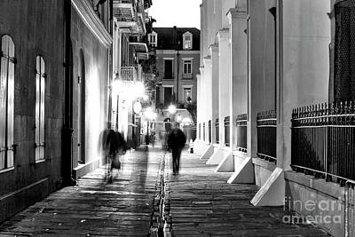 Photograph - Night Walkers In Pirates Alley by John Rizzuto