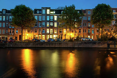Photograph - Nighttime Over One Of The Canals Of Amsterdam, Netherlands by Alfio Finocchiaro
