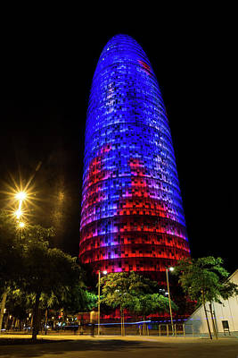 Photograph - Nocturnal Illumination - Torre Agbar Barcelona Soft Golden Glow by Georgia Mizuleva