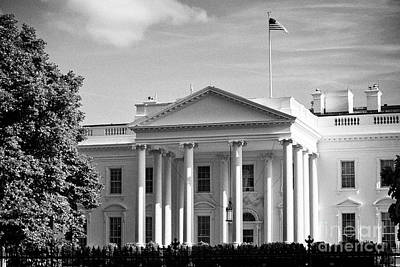 Whitehouse Wall Art - Photograph - north facade of the White House with flag flying Washington DC USA by Joe Fox