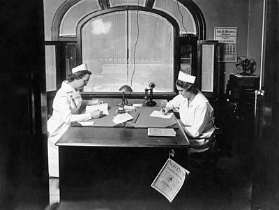 Healthcare And Medicine Photograph - Nurses Doing Paperwork by Underwood Archives