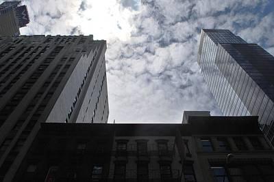 Photograph - Nyc Buildings - Sun Breaks Through Clouds by Matt Harang