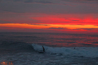 Photograph - Oahu Surfers At Sunset by Michael Rucker