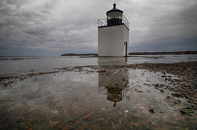 Photograph - Ocean Wearing Away At Lighthouse by Jeff Folger
