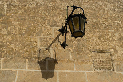 Photograph - Of Lights And Shadows - Medieval Looking Streetlamp In Mdina The Ancient Capital Of Malta by Georgia Mizuleva