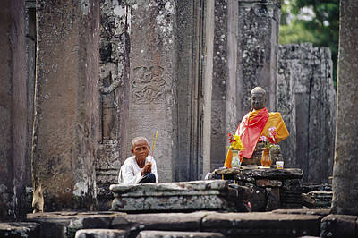 Religious Characters And Scenes Photograph - Offerings Made To Buddha At Angkor Wat by Steve Raymer