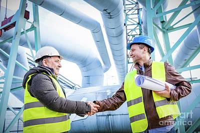 Energy Photograph - Oil Refinery Engineers Successful Deal Handshake. by Michal Bednarek