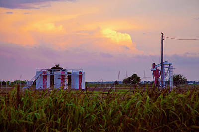 Photograph - Oil Tanks And A Stormy Sunset by Toni Hopper