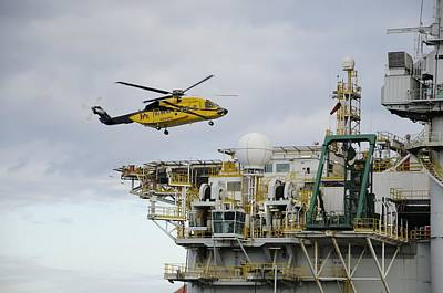 Photograph - Oil Worker Helicopter Landing On Rig. by Bradford Martin