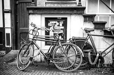 Photograph - Old Bike In Amsterdam by John Rizzuto