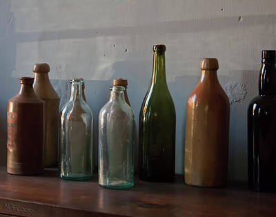 Photograph - Old Bottles In North Light by Michael Flood