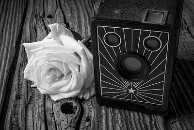 Old Camera And White Rose Art Print by Garry Gay