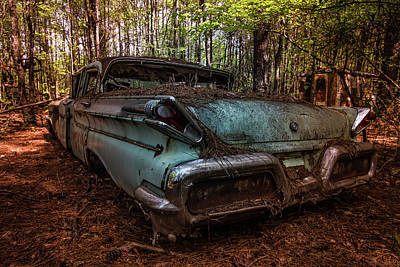Photograph - Old Car In The Woods by Menachem Ganon