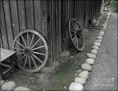 Photograph - Old Cart Wheels by Eena Bo