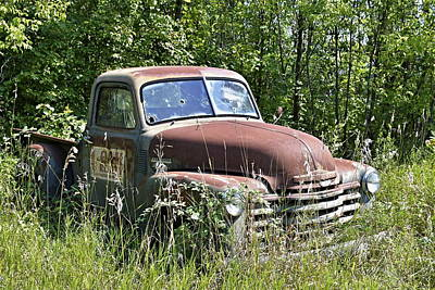 Photograph - Old Cheverolet Pickup Truck Sitting In A Field by Steven Liveoak