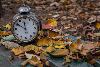 Photograph - Old Clock On Autumn Leaves by Julian Popov