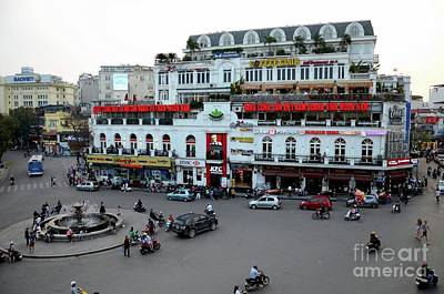 Photograph - Old Colonial Building And Roundabout With Fast Food Restaurants Hanoi's Old Quarter Vietnam by Imran Ahmed