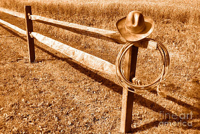 Fencepost Photograph - Old Cowboy Hat On Fence - Sepia by Olivier Le Queinec