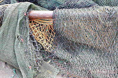 Art Print featuring the photograph Old Discarded Fishing Nets by Yali Shi