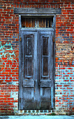 Old Door With Bricks Art Print by Perry Webster
