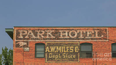 Photograph - Old Faded Advertisement On An Old Brick Building by Edward Fielding