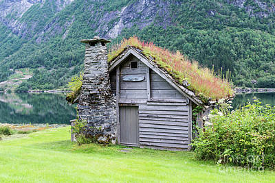 Photograph - Old Fairytale Like House Of Wood With Chimney Of Stacked Slate   by Compuinfoto