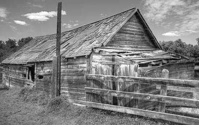 Photograph - Old Farm Shed In Monochrome by Jim Sauchyn