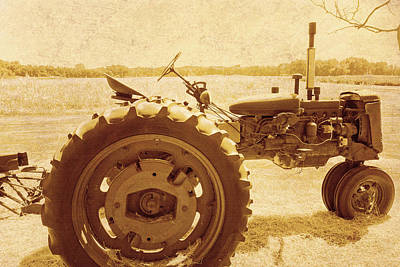 Photograph - Old Farm Tactor In Sepia by Ann Powell