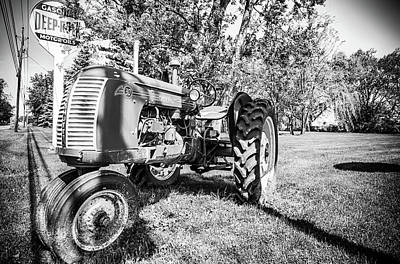 Photograph - Old Farm Tractor In Black And White by Anthony Doudt