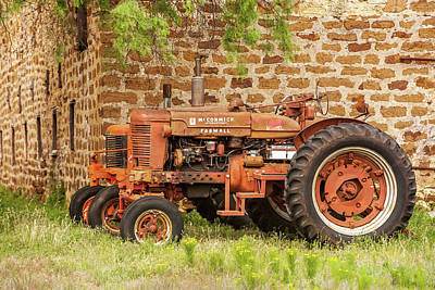Photograph - Old Farmall Tractors by Art Block Collections
