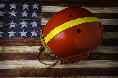 Old Football Helmet On American Flag Art Print by Garry Gay