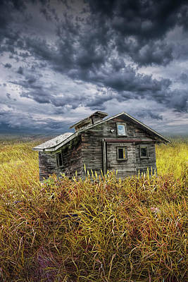 Photograph - Old Forlorn Decrepit Building In A Field Of Brown Prairie Grass Under Threatening Skies by Randall Nyhof