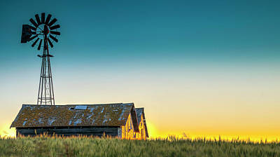 Photograph - Old Grain Bins Against The Late Evening Sky by Philip Rispin