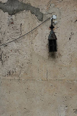 Photograph - Old Lantern On A Weathered Wall by Marco Oliveira