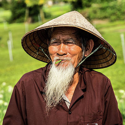 Que Photograph - Old Man Of Vietnam by Lahiru Ranasinghe