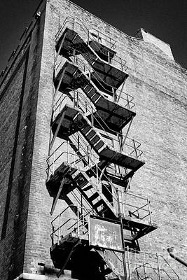 Fireescape Photograph - Old Metal Fire Escape On Side Of Red Brick Warehouse Building Liverpool Docks Uk by Joe Fox