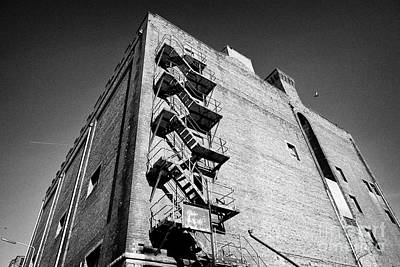Fireescape Photograph - Old Metal Fire Escape On Side Of Red Brick Warehouse Building Liverpool  by Joe Fox
