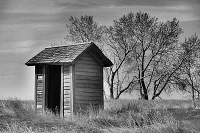 Birds Rights Managed Images - Old outhouse in BaW Royalty-Free Image by Jeff Swan