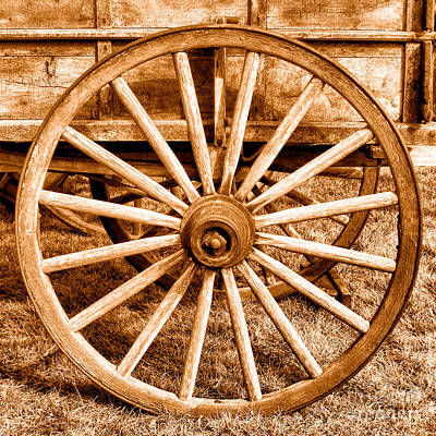 Wagon Wheels Photograph - Old Prairie Schooner Wheel - Sepia by Olivier Le Queinec