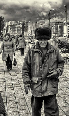 Photograph - Old Russian Man Wearing A Ushanka And The Windy Storm by John Williams